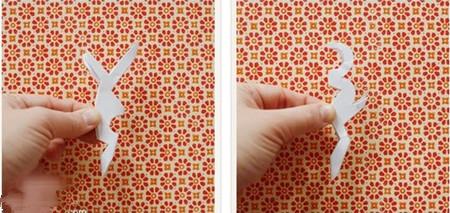 第三步:对折成小正方形时,再接着对角折两下,折成上图的一个形状.