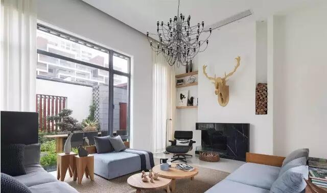 项目面积:1200平方      装修风格:现代北欧风格      别墅一楼的客厅图片