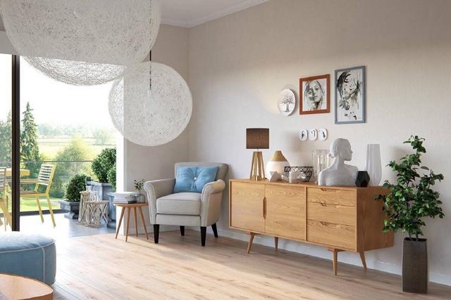 矮背布艺沙发和几款尖腿家具,几乎也是多数典型北欧风格的必备品.图片