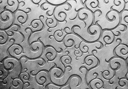 金属壁纸,就是在基层上涂上金属膜的壁纸,其观感是金碧辉煌、庄重大方,适合用在KTV、酒店等气氛热烈的地方。金属壁纸的质感和空间感强,它的使用可以增加贵气,增添墙面的层次感和立体感。不过,建议在使用时合理搭配。  金属壁纸材质 金箔壁纸,纸面上加上金属(金、银、铜、铂等)印花而成,给人金碧辉煌、庄重大方的感觉,耐抗性好。
