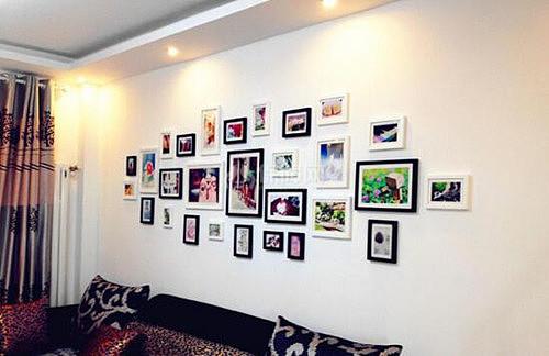 墙壁装饰可以设计成照片墙也是很不错的,可以将照片摆成不同的造型,为图片