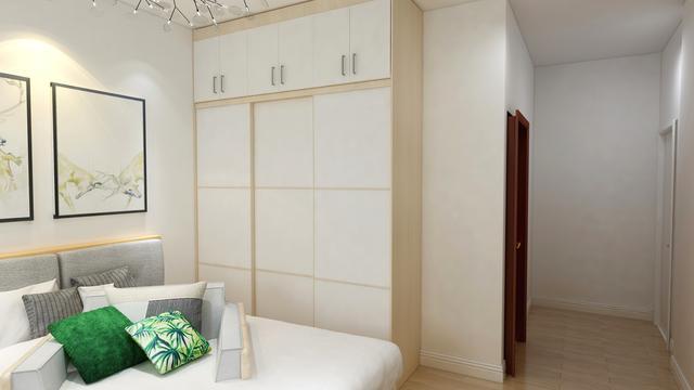 卧室衣柜到顶石膏线装修 既美观又实用