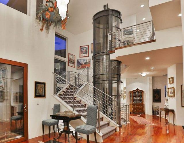 复式楼现在流程装小型电梯 漂亮不占空间还实用