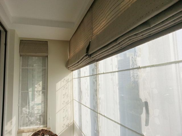 客厅阳台一体设计,窗帘应该挂在哪?怎么挂?